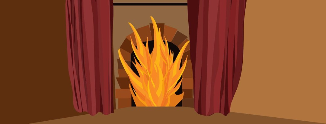 A large open furnace with flames and fancy red curtains.