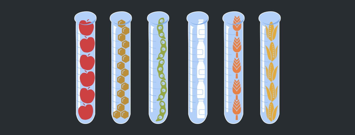A series of test tubes lined up with different foods inside