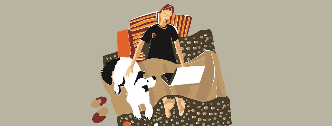 Person curled up in bed with laptop and dog