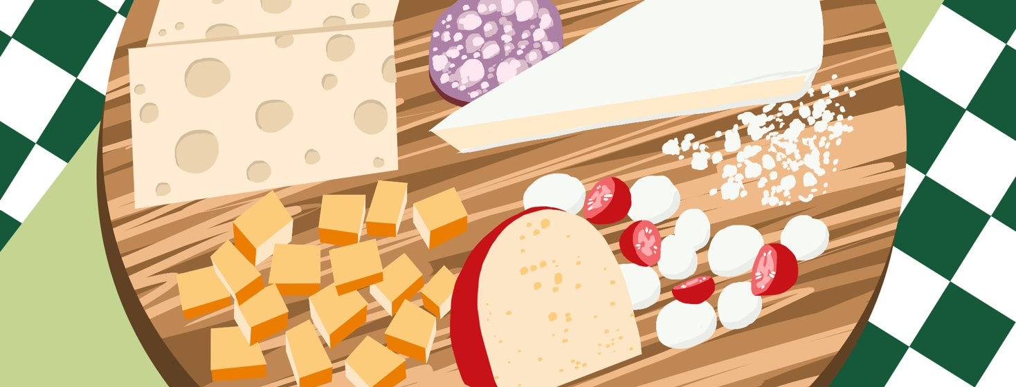 A cheese platter features a variety of cheeses that are listed as low FODMAP foods.