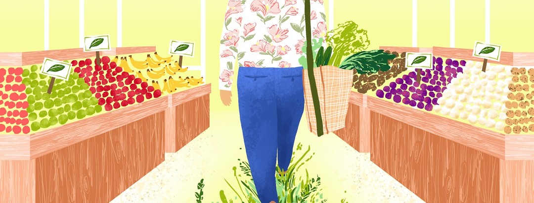 A person walks through an organic market as plants spring up beneath their feet and leave a grassy path behind.