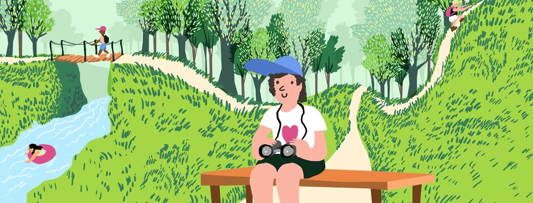 A person sits on a bench on a trail, content to be birdwatching while behind them, other people with more mobility and fewer restricting health conditions follow other, more strenuous nature paths.