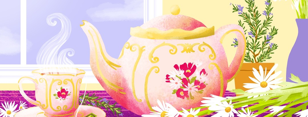 A flowery teapot and steaming cup of tea sit on a brightly lit table surround by flowers and herbs used in herbal teas.