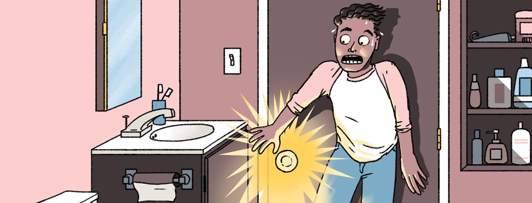 A panicked man in a bathroom is in hysterics as he notices that there is no lock on the door.