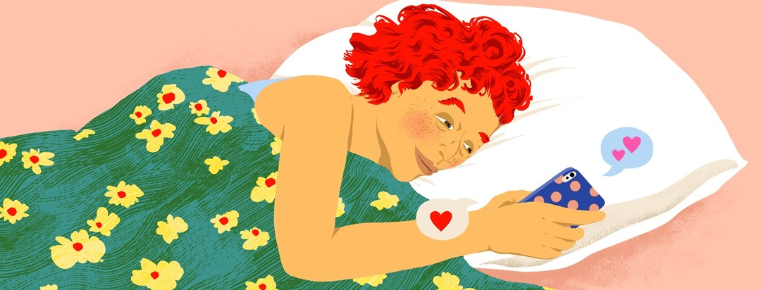A tired but relieved-looking woman lies on her side in bed while texting on her phone. Two different speech bubbles coming out of the phone both contain heart emojis.