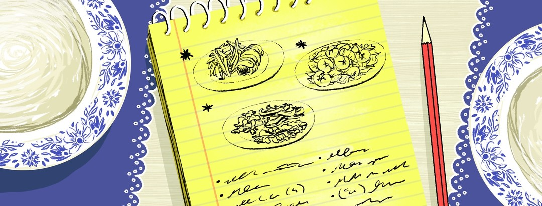A yellow notepad sits on a table between two blue and white plates with decorative edges. On the pad is draw three meals with stars next to them and below, a scribbled list.