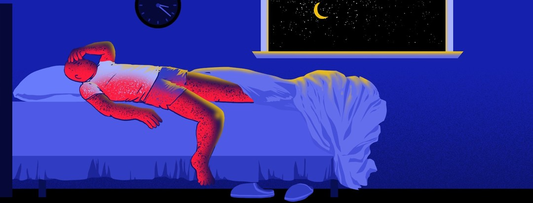 A man lies uncomfortably in bed, with one leg and arm over the side of the mattress to begin to get out of bed due to discomfort.