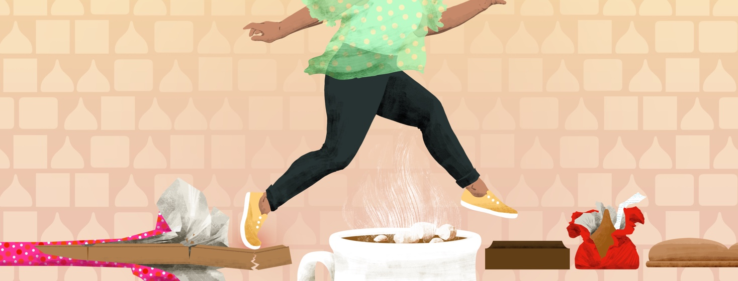 A woman lightly jumps from a cracking bar of milk chocolate over a mug of hot cocoa, onto a square of dark chocolate.
