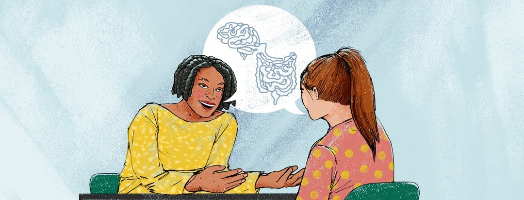 A psychologist speaks to a patient about the connection between the brain and the GI tract, as seen in a speech bubble between them.