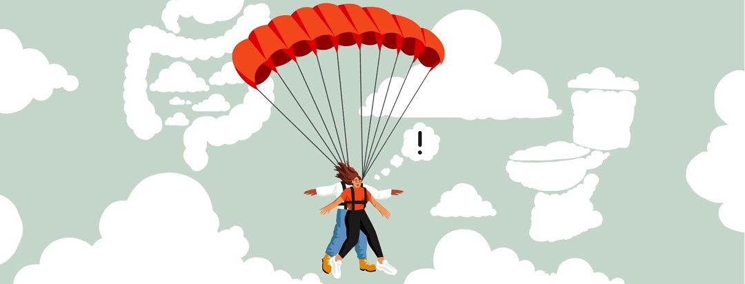 A woman strapped to an instructor is floating through the air with a parachute past clouds shaped like a GI tract and toilet. She looks alarmed and has a thought bubble coming from her head with an exclamation point in it.
