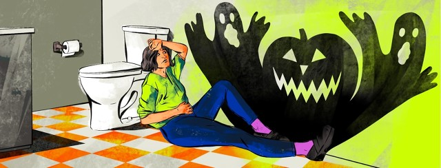 A woman looking sick and exhausted sits on the bathroom floor leaning against the toilet. A shadow of two ghosts and an evil jack-o-lantern is cast on the wall next to her.