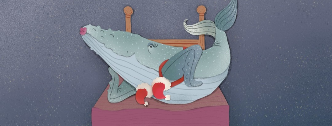 Blue whale posing on a bed wearing a Santa hat bra and red lipstick