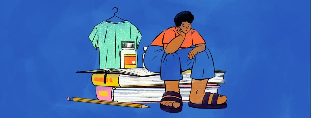 A person sits on a stack of books, looking sad and defeated. Behind them is an open journal, two bottles of medication, and a hospital gown on a hanger.
