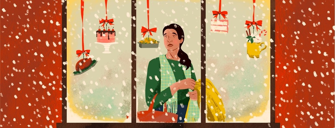 A woman is viewed through a store window. She is holding a bag and jacket and looking sadly at blown glass ornaments hanging in the window depicting different kinds of decadent foods. It is snowing outside the window.