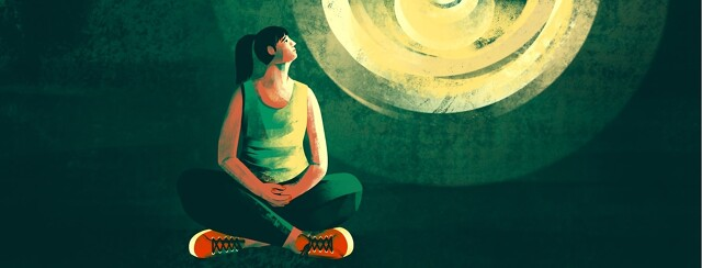 A woman sitting on the floor alone in the dark looks up at a hopeful light shining above her.