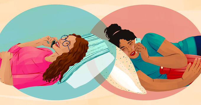 alt=two woman lying against pillows with their hands on their stomachs talk on the phone to each other.