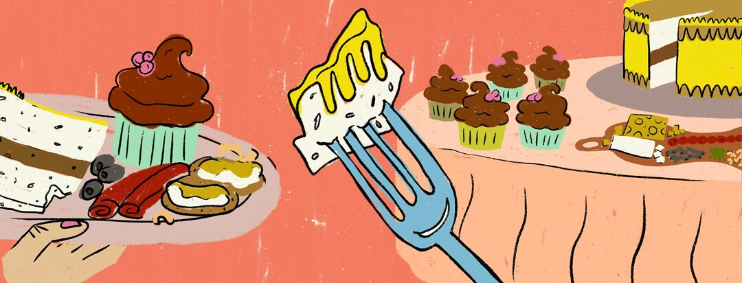 A table of food in the background, and hand holding a plate, and a fork with a bite of cake on it in the foreground.