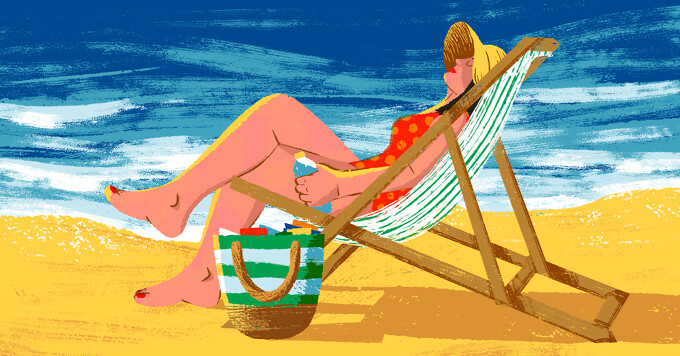 alt=A woman relaxes in a beach chair next to the ocean and a large bag full of items.