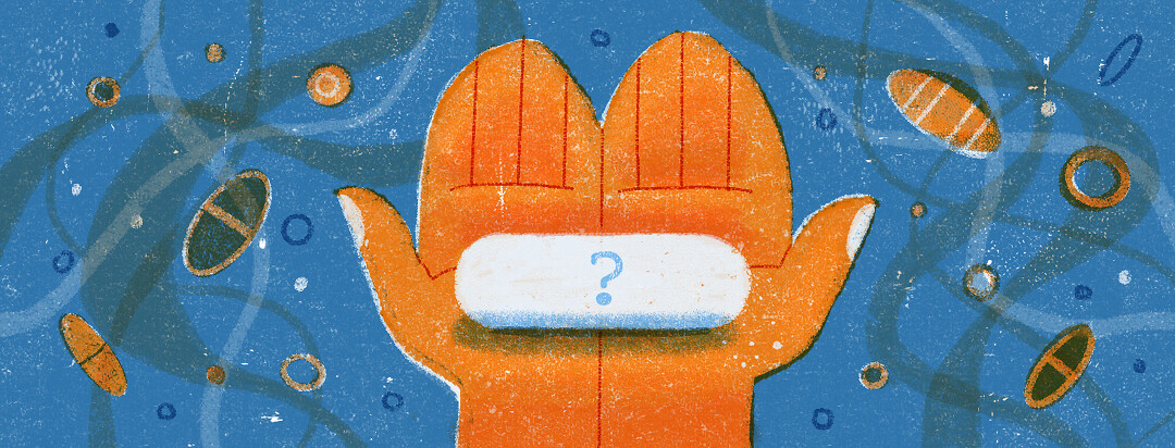 Holding a mystery pill in both hands