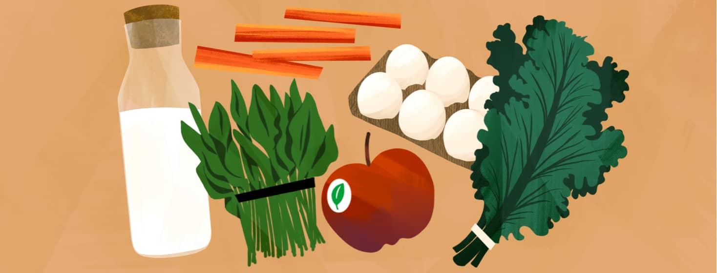 alt=leafy greens, an apple, cut carrots, milk, eggs