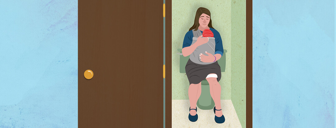 A woman is sitting on a toilet in her home while wearing her sleeping baby.